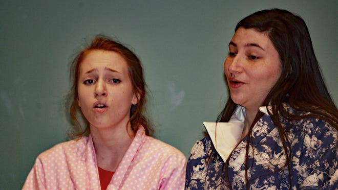 """Eileen (Kellie Wright) and Ruth (Savannah Terry) contemplate the wisdom of their decision to move to New York in the Owego Free Academy production of """"Wonderful Town."""""""