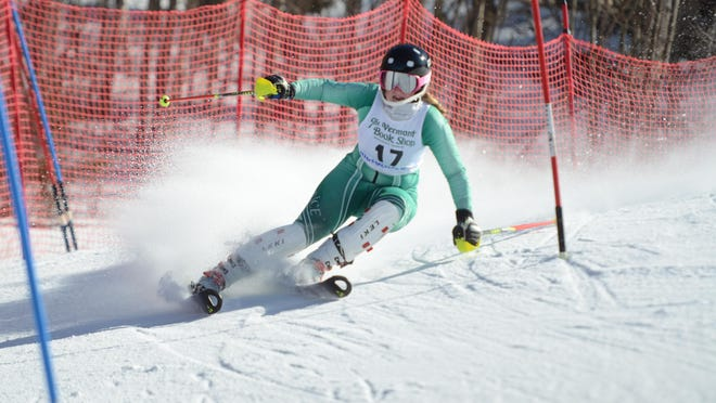 Sophomore Sarah Boland of Rice cranks through a gate entering the bottom stretch of the slalom course during Day 2 of the alpine skiing state championships at Middlebury Snow Bowl on Thursday. Boland finished third with a combined time of 1:20.32 to help lift the Green Knights to their first-ever state title.