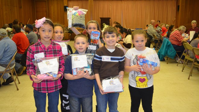 Third-grade students from Petway Elementary School volunteered at the Spirit & Truth Ministries Easter luncheon on Saturday at First Presbyterian Church on Landis Avenue. Pictured in front from left are Marlene Jimenez, 9, Joseph Sharp, 9, Justin Mastro, 8, Marley Smith, 8, all of Vineland. In the back row are Kristen Wareham, 9, and Hope Preidt, 9, both of Vineland.