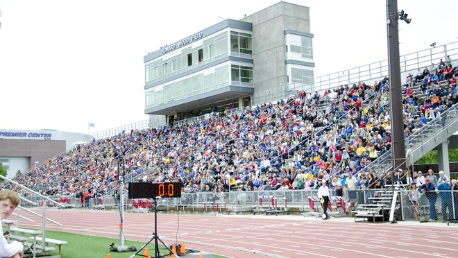 Fans packed the west side of the stands after a rain delay Saturday, May 28, during the state track meet at Howard Wood Field in Sioux Falls.