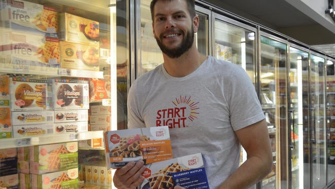 Clint Matthews, an Ozark native, holds up Start Right waffles, a company he co-founded. The Price Cutter in Ozark just started stocking the waffles which are available in other locations.