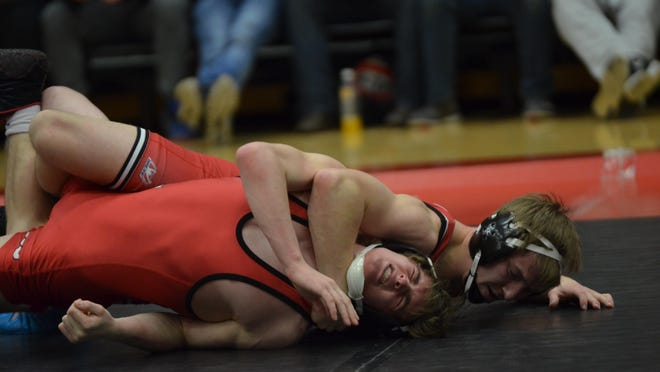 St. Cloud State's James Pleski takes on Jake Fernholz of St. John's at 149 pounds during the nonconference dual meet between the Huskies and Johnnies Thursday night at Halenbeck Hall.
