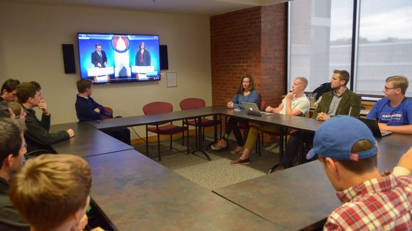 The KU Young Americans for Freedom chapter watches footage of Utah senator Mike Lee's debate against Democratic challenger Misty Snow.