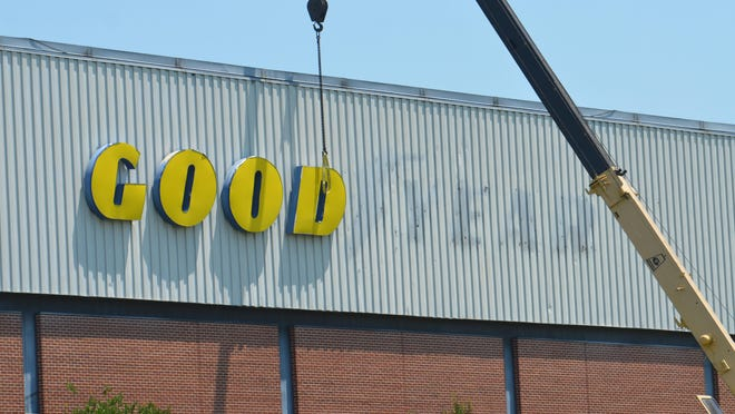 Crews were working Tuesday to remove the Goodyear logo from the company's Gadsden plant that shut down last month after more than 91 years in operation.