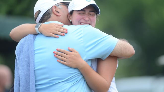 Alexis Florio gets a hug from her father, Peter, after winning the RIGA Women's Amateur Championship Friday at Montaup Country Club.
