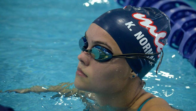 MLA's Kasia Norman watches the clock as she prepares to start a set in practice at Holland Community Aquatic Center.