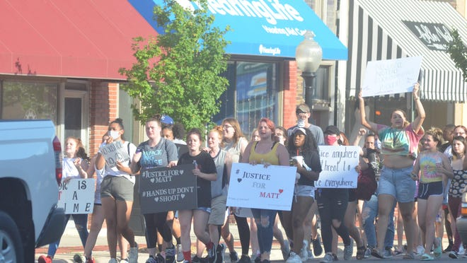 "Marchers head to the courthouse during the ""Justice for Matt"" walk on June 3 in Newton."