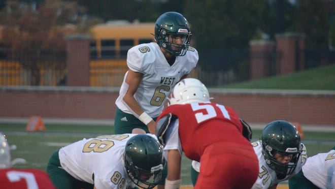Carson Gulker and the Zeeland West football team take on Muskegon in a showdown of state powers.
