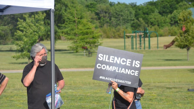 During a recent rally for social justice, the Newton Community for Racial Justice called for a review of local law enforcement agencies' use of force policies.