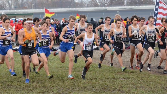Luke Butler of Monroe High (888) takes off in the Division 1 boys race at the state finals last year. He finished 131st overall with a time of 16:55.