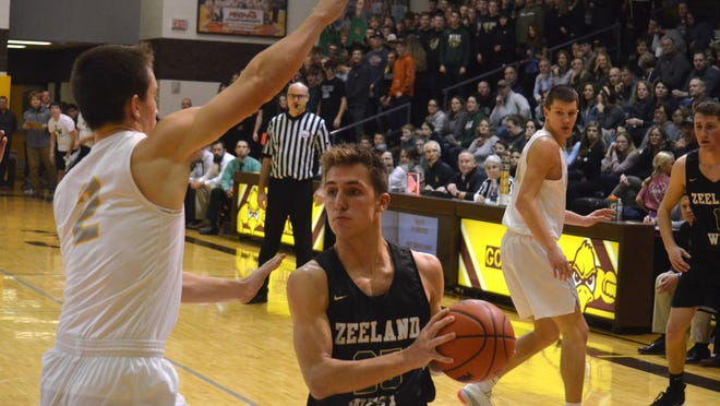 Zeeland West's Carson Gulker (center) leads the Dux into the basketball season.