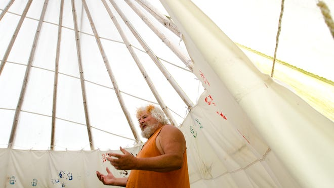 Ivan McBeth stands in a teepee noting the conical shape preferred in the practice of Druidry at his Dreamland property on June 11.