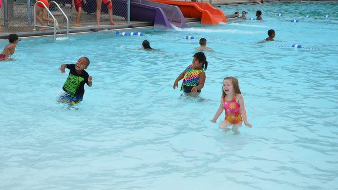 Children swim and dance in this file photo at the city's pool.