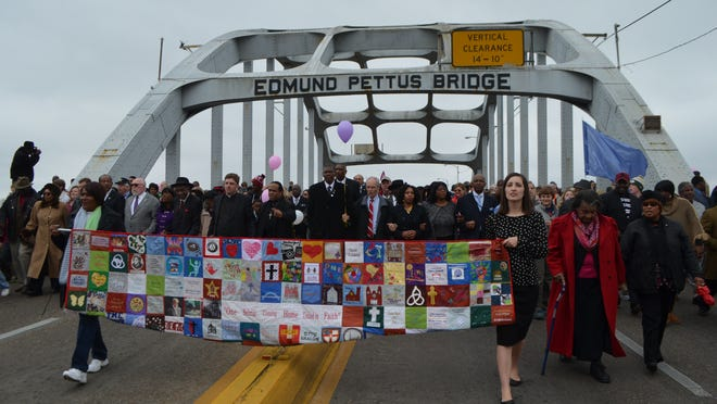 More than 1,500 area residents walked behind a huge quilt depicting positive things about Selma during Sunday afternoon's Unity Walk. Local churches supported the event.