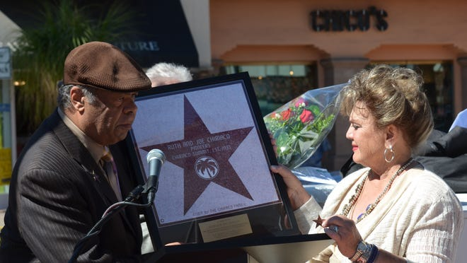 Margit Chiriaco Rusche receives a replica of the 380th star on the Palm Springs Walk of Stars during Tuesday's ceremony.