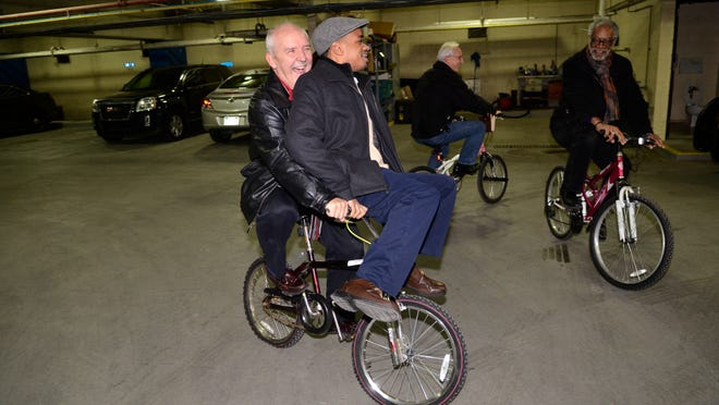 Tom Seppo, of Operation Transformation, gives Tray Smith, of Faith Christian Community Church, a ride at the Port Huron Municipal Office Center on a donated bike. Riding with Seppo are Mark Seppo, of Marysville Assembly of God and Carl Miller, of Restoration Church.