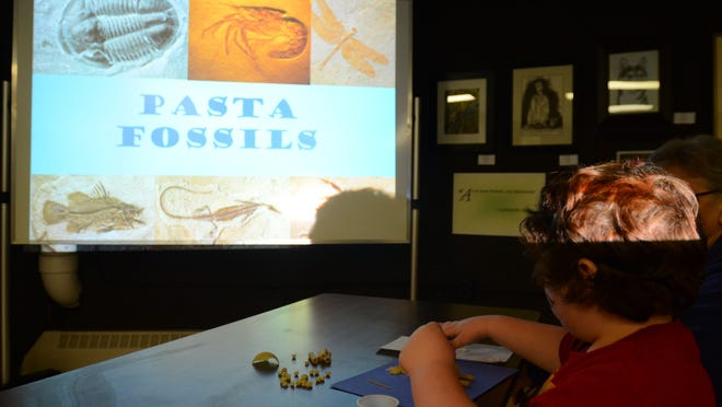 Wendell Everts, 7, of Port Huron, made a butterfly and bear skeleton out of pasta on Thursday. Port Huron Museum hosted a pasta fossil activity for students on spring break.