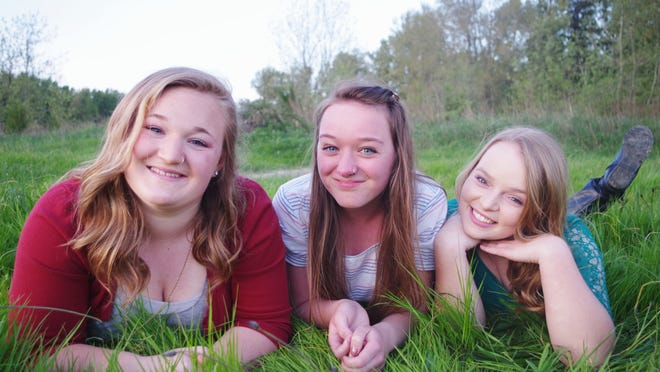 """Four young women, including Kourtney Galyen (left to right) McKenzie Gilberts and Alicia Zieg, are planning a cross-country mission trip they call """"Dare You to Move."""" They plan to help out churches and communities as they travel more than 11,000 miles and make stops in 25 states."""
