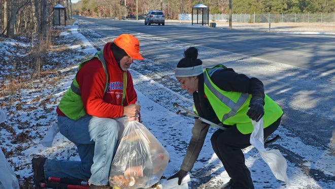 John Pedersen and Jasmine Delatorre bag litter along Mays Landing Road in Vineland.