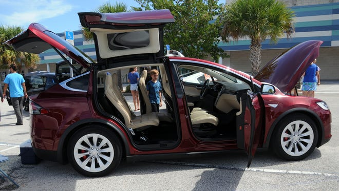 A Tesla Model X on display during Saturday's National Drive Electric Week event at the David R. Schechter Community Center.