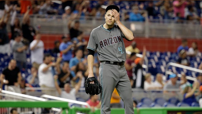 Arizona Diamondbacks starting pitcher Patrick Corbin reacts after giving up a two-run home run to Miami Marlins' Justin Bour during the first inning of a baseball game, Friday, June 2, 2017, in Miami. The Marlins scored four runs in the inning. (AP Photo/Lynne Sladky)