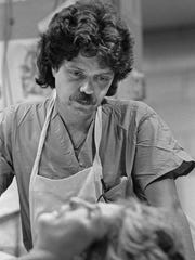 Dr. George Nichols established the Kentucky Medical Examiner's Office in 1977 and was the state's first Chief Medical Examiner, a position he held for 23 years, performing in excess of 10,000 autopsies. This is from a set of photographs taken from 1977 when Dr. Nichols was beginning his tenure.