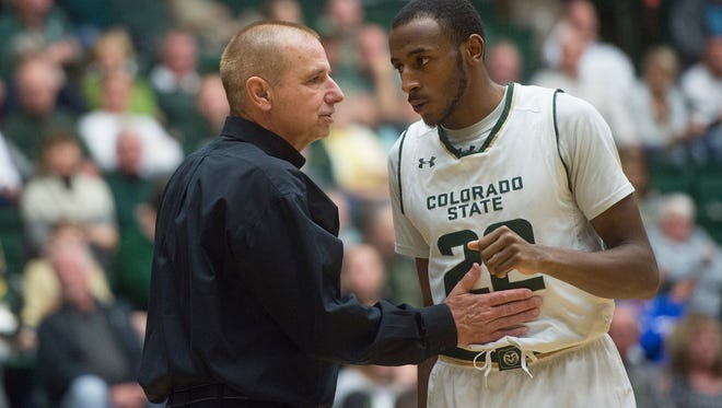 CSU men's basketball coach Larry Eustachy talks with guard J.D. Paige during a break in the action in a Jan. 17 game against Air Force at Moby Arena.