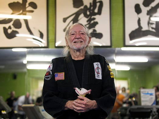 Willie Nelson, the country music star who turns 81 on April 29, smiles as he receives his fifth-degree black belt in the martial art of GongKwon Yu Sul.