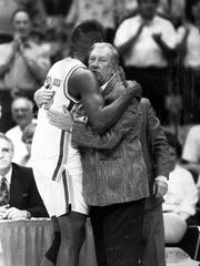 Marlon Masey gives Coach Don Haskins a bear hug after the Miners' victory over the rival Lobos.
