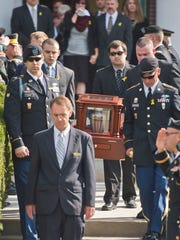 Pallbearers carry Joshua Pallotta's remains during his funeral ceremony at Ira Allen Chapel in Burlington on Sept. 29, 2014. Pallotta, a soldier with the Vermont Army National Guard's Alpha Company, 3rd Battalion, 172nd Infantry, 86 Infantry Brigade Combat Team (Mountain) and deployed to Afghanistan in 2009, took his own life after battling post traumatic stress disorder and traumatic brain injuries.