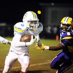 Sumrall player Dannis Jackson (5) runs pass the Purvis High School defense on Friday at Purvis.