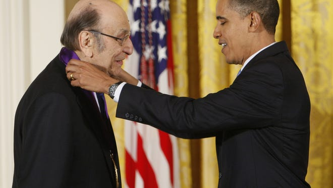 In this Feb. 25, 2010, file photo, President Barack Obama presents a 2009 National Medal of Arts to Milton Glaser in the East Room of the White House in Washington.