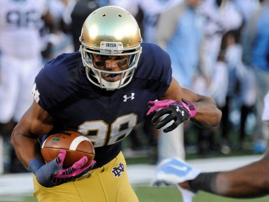 FILE - In this Oct. 11, 2014, file photo, Notre Dame wide receiver Corey Robinson makes a catch during an NCAA college football game against North Carolina in South Bend, Ind. Robinson is not worried that being the first Notre Dame football player elected to be the student body president will be a distraction. (AP Photo/Joe Raymond, File)