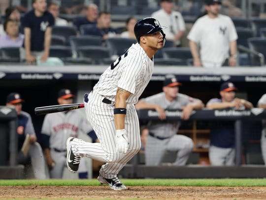 New York Yankees' Gleyber Torres heads to first with a single that drove in the winning run during the 10th inning of the team's baseball game against the Houston Astros on Tuesday, May 29, 2018, in New York. The Yankees won 6-5. (AP Photo/Frank Franklin II)