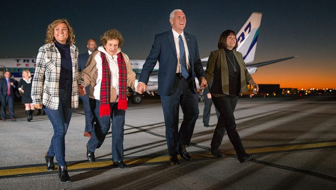 Vice President-elect Mike Pence, his daughter Charlotte, his wife Karen  and his mother Nancy walk toward the crowd after stepping off the plane during a welcome home rally for Pence at the Indianapolis International Airport, Indianapolis, Thursday, November 10, 2016. Pence returned home for the first time since he and Donald Trump won the election.