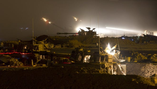 Two Israeli canons fire into the Gaza Strip on Monday.