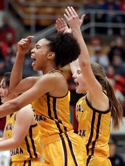 Central Michigan's Tinara Moore, left, and Kyra Bussell celebrate after CMU's 78-69 win in the first round of the the NCAA women's tournament, Saturday, March 17, 2018, in Columbus, Ohio.