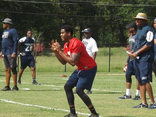 Tiger quarterback Brent Lyles prepares to take a snap