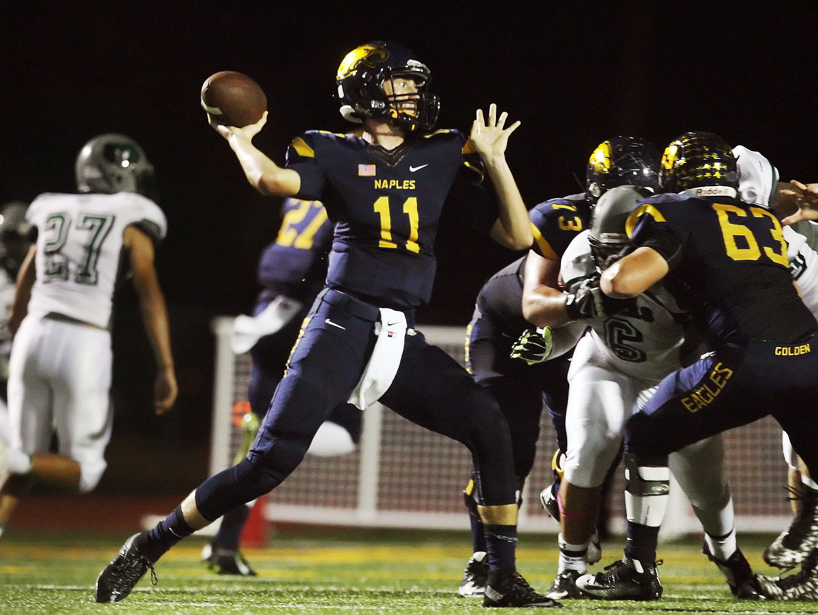 Naples High School's Kieran DiGiorno passes for a first down against Palmetto Ridge on Friday at Naples High School.