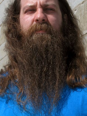 "Bryan Sturge, of Barre,  shows off his beard, in Montpelier, that he entered into the ""Vermont Beardies"" competition. Sturge says he grew his beard to honor his daughter who died of cancer in 2013 before her Make-a-Wish request to go to Disney World and swim with dolphins could be granted. The competition in Burlington was a fundraiser for Make-a-Wish Vermont."