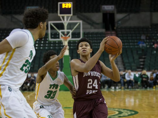 Don Bosco's Ronald Harper drives to the basket while guarded by The Patrick School's Al-Amir Dawes during second-half action in Monday's Tournament of Champions Final at Sun Center in Trenton.