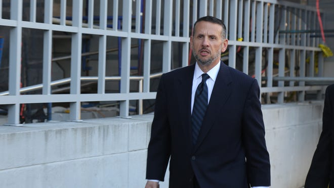 Prosecution witness David Wildstein leaves the federal courthouse in Newark after his first day of testimony on Friday, Sept. 23.