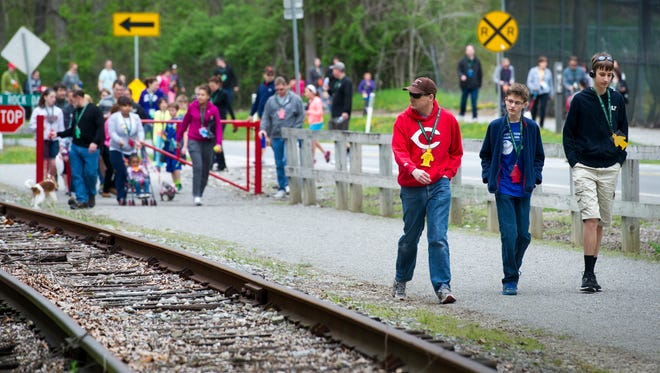 Residents walk along the York County Heritage Rail Trail, in this file photo of the 13th annual Jewish Family Services' Walkathon in May 2014.