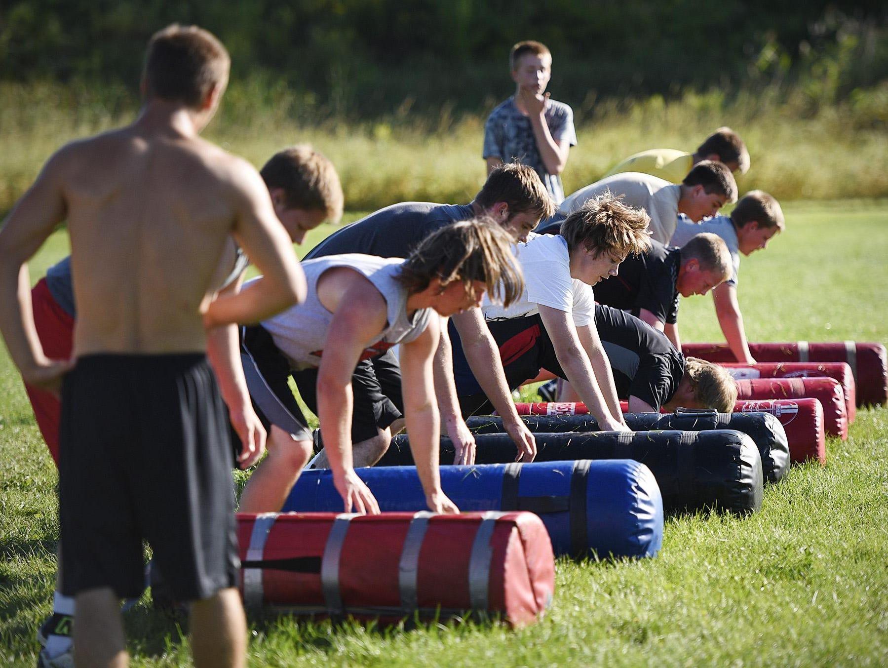 Milaca players run agility drills Tuesday.