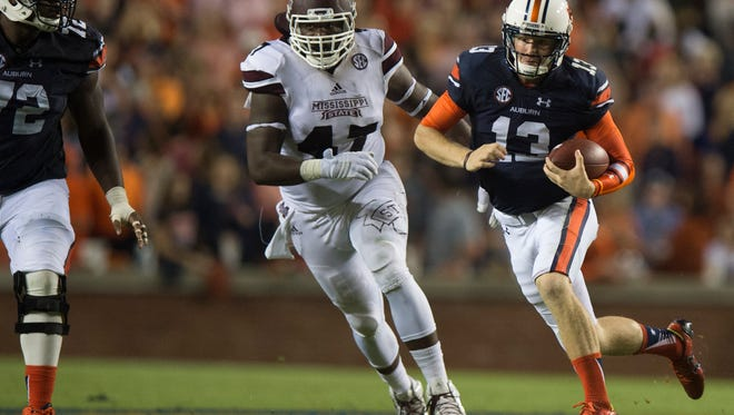 Auburn quarterback Sean White (13) runs downfield during the NCAA football game between Auburn and Mississippi State on Saturday, Sept. 26, 2015, at Jordan-Hare Stadium in Auburn, Ala. Mississippi State Bulldogs defeated Auburn 17-9.