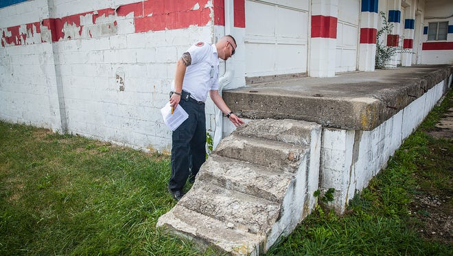 State building inspector Aaron Elsworth checks out the exterior of the former Southside Community Center on Thursday, Oct. 8, 2015. The city proposed the popular backyard haunted house, The Organ Trail, might be able to relocate to property surrounding the abandoned building. The building itself did not pass a safety inspection according to Elsworth.