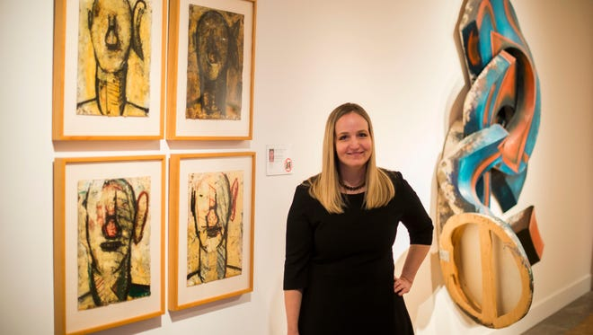 Laurie Ann Farrell, the Detroit Institute of Arts' new curator of contemporary art stand in the contemporary galleries with four drawings by Detroiter Gordon Newton and a shaped-canvas painting by Elizabeth Murray on Friday Oct. 28, 2016.