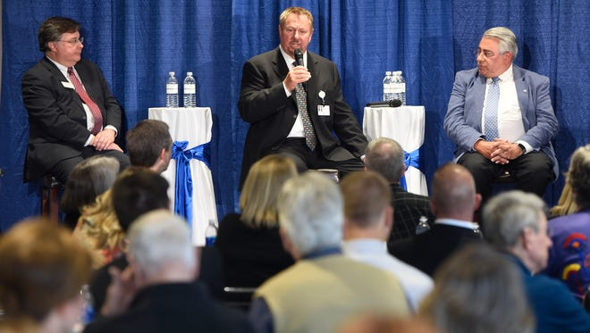 CentraCare President and CEO Ken Holmen, center, and local economists Louis Johnston, left, and King Banaian, right, answer questions from the audience during the CentraCare report to the community Wednesday, Oct. 4, at the River's Edge Convention Center in St. Cloud.