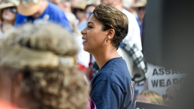Pam Keith stands in a crowd at the March For Our Lives rally at the Memorial Park bandshell in downtown Stuart.
