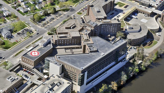 An aerial photograph shows the Mississippi River side of St. Cloud Hospital.